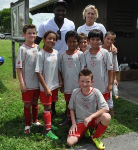 Altidore with Barbara Schulz and a Schulz Academy team